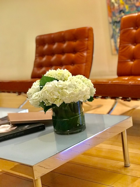 Beautiful flowers on a table in the waiting room of Advanta Dental Group, a dentist office in Emeryville, CA